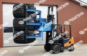 Pinza idraulica per presa multipla di pneumatici veicoli industriali , adattabile a carrello elevatore in possesso gia del cliente .